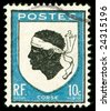 vintage postage stamp with Corsica national emblem of a Moorish head - stock photo