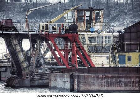 Vintage postcard of ships moored at a shipyard - stock photo