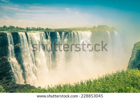 Vintage postcard of Victoria Waterfalls - Natural wonder of Zimbabwe - Continent of Africa - stock photo