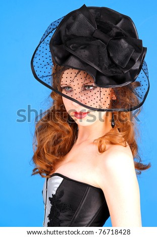 Vintage professional model in hat on blue background