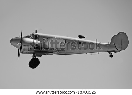 Vintage propeller airplane in mid flight