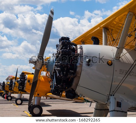 Vintage Propeller Airplanes Lined Up at Airshow - stock photo