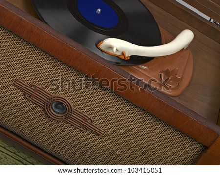 Vintage radio-gramophone with a gramophone record - stock photo