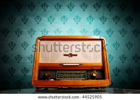 vintage radio on blue background - stock photo