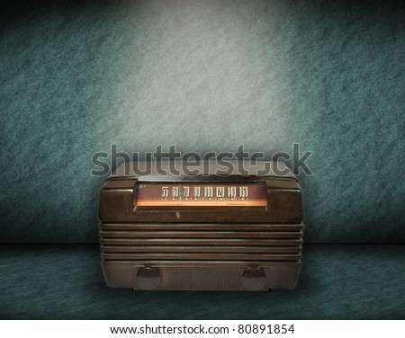 vintage radio on green background - stock photo