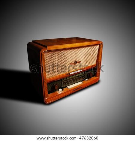 vintage radio on grey background - stock photo