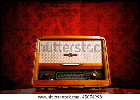 vintage radio on red background - stock photo