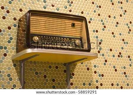 vintage radio on yellow background - stock photo