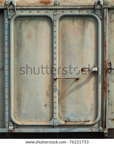 Vintage railroad container door with rusty roof. - stock photo