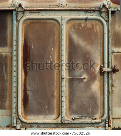 Vintage railroad container doors with rusty and old color.