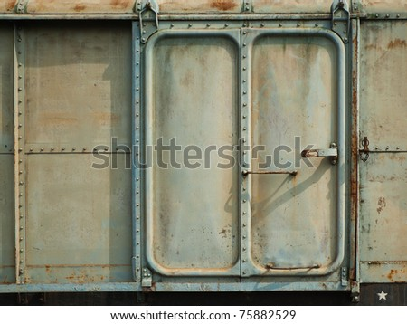 Vintage railroad containner doors with rusty and old color. - stock photo