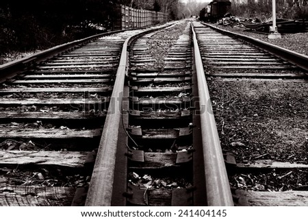 Vintage railway tracks in black and white - stock photo