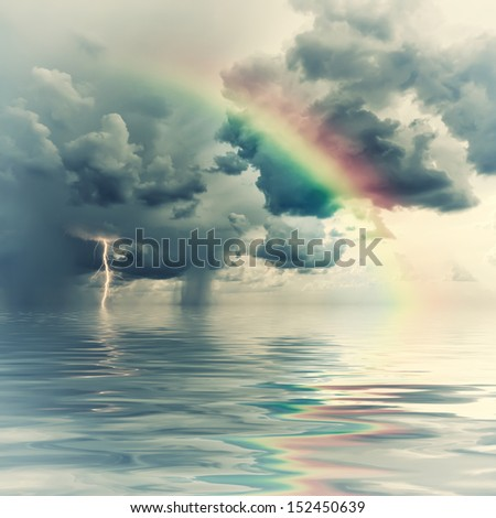 Vintage rainbow over ocean, thunderstorm with rain and lightning on background
