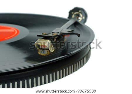 Vintage record player. Needle head and disc - stock photo