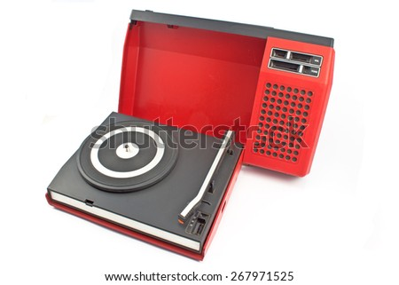 Vintage record player - portable turntable isolated on white - stock photo
