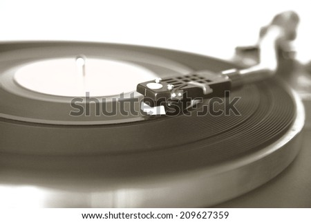 Vintage record player with noise and grain for old look of the photo - stock photo