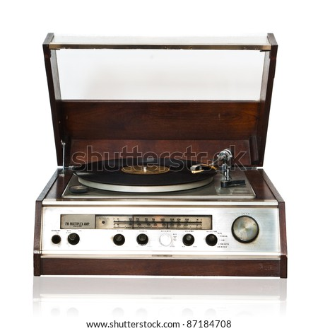 Vintage record player with radio tuner isolated on white background - stock photo