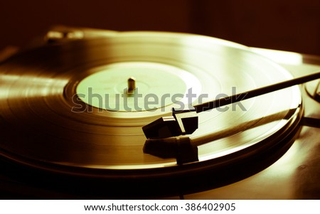 Vintage record player with vinyl disc, close-up - stock photo