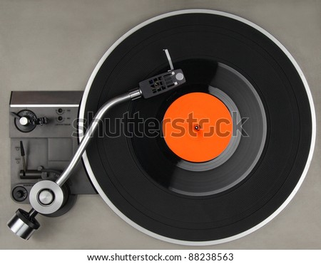 Vintage record player with vinyl phonorecord