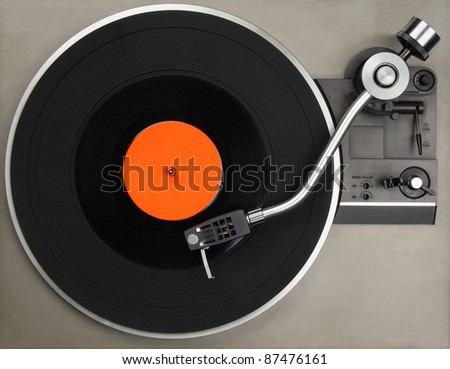 Vintage record player with vinyl record - stock photo