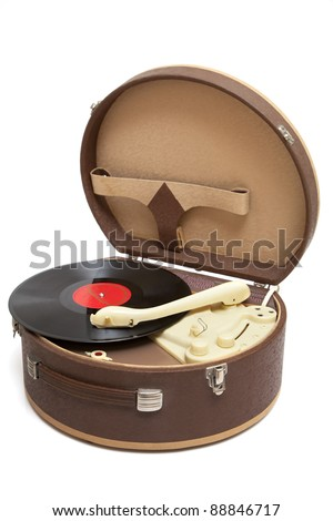 Vintage record player with vinyl record isolated on a white - stock photo