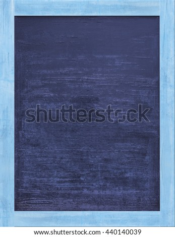 Vintage rectangular dark blue chalkboard/blackboard with light blue wood frame, with traces removing or erase. - stock photo