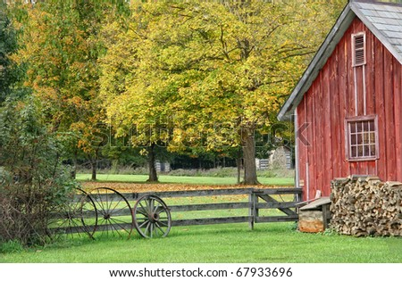 VIntage Red Barn with Wagon Wheel - stock photo