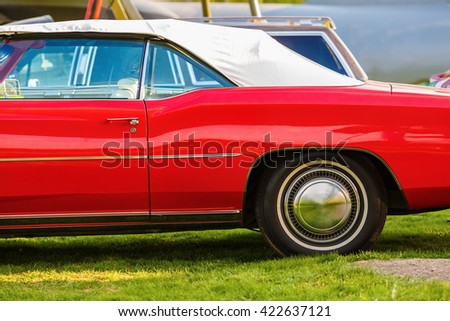 Vintage red car. Close-up of old retro auto. - stock photo