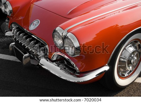 Vintage red Chevrolet Corvette sports car with chrome trim - stock photo