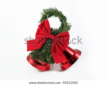 Vintage Red Christmas Holiday Bells with Red Bow and Garland isolated on white background - stock photo