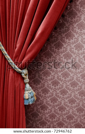 Vintage red curtain on a floral wallpaper - stock photo