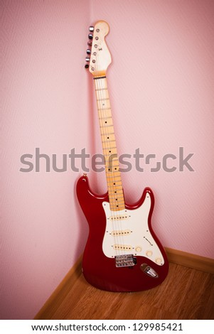 Vintage red electric solid body guitar - stock photo