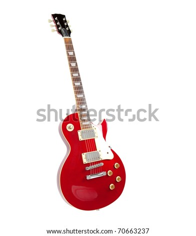 Vintage red electric solid body guitar,standing. Isolated on white. - stock photo