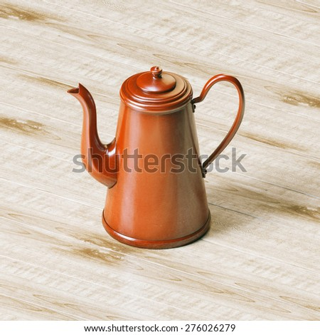 Vintage red enamel coffee kettle on wooden panel background  - stock photo