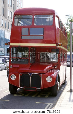 Vintage Red London Bus at a Bus Stop - stock photo