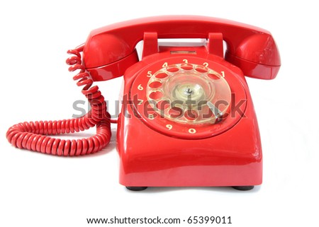 Vintage red phone isolated on a white background. - stock photo