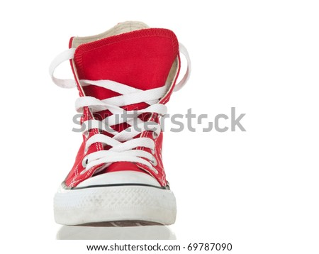 Vintage red shoe closeup on pure white background - stock photo