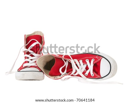 Vintage red shoes fallen on pure white background - stock photo