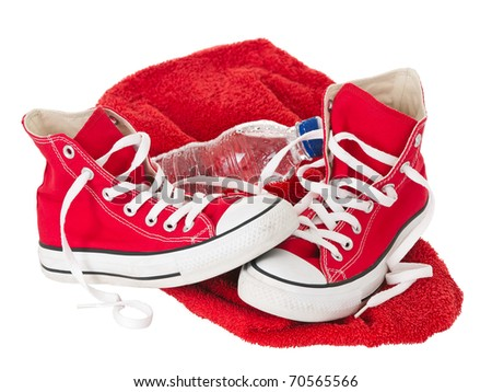Vintage red shoes with towel on pure white background - stock photo