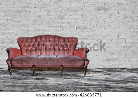 Vintage red sofa in the room and marble floor.
