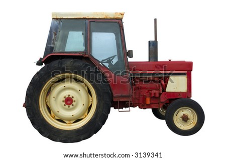 Vintage red tractor with rust and mud splashes, isolated on white