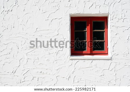 Vintage red window on the white wall - stock photo