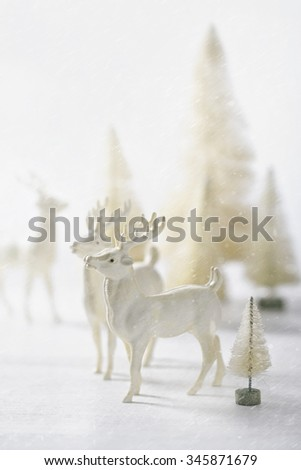 Vintage reindeer ornaments for Christmas decorating - stock photo