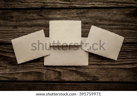 Vintage retro aged empty photo paper on wood texture  background