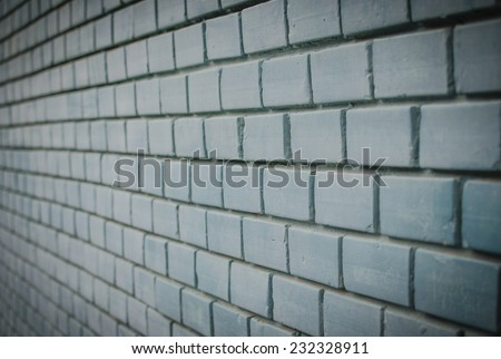 Vintage, retro blue brick wall with black amount / background