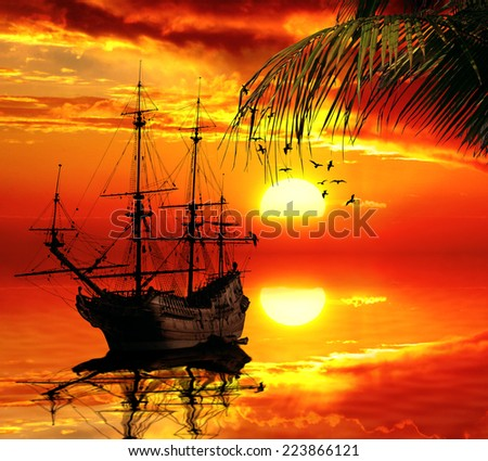 Vintage retro classic old sailboat on a sunset skyline sky light background with palm tree on foreground. Travel, vacation, voyage, tropical paradise trip, adventure, tourism concept  - stock photo