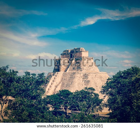 Vintage retro effect filtered hipster style image of ancient mayan pyramid (Pyramid of the Magician) in Uxmal, Merida, Yucatan, Mexico - stock photo