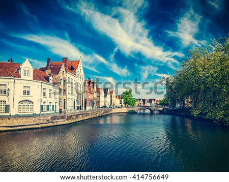 Vintage retro effect filtered hipster style image of  canal, bridge and row of old houses, Bruges (Brugge), Belgium - stock photo