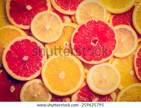 Vintage retro effect filtered hipster style image of colorful citrus fruit - lemon, orange, grapefruit - slices background - stock photo
