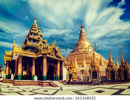 Vintage retro effect filtered hipster style image of Myanmer famous sacred place and tourist attraction landmark - Shwedagon Paya pagoda. Yangon, Myanmar - stock photo